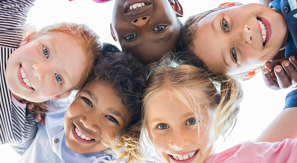 group of diverse children together smiling